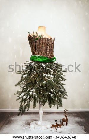 Festive Christmas vintage tailors dummy decorated naturalistically - stock photo