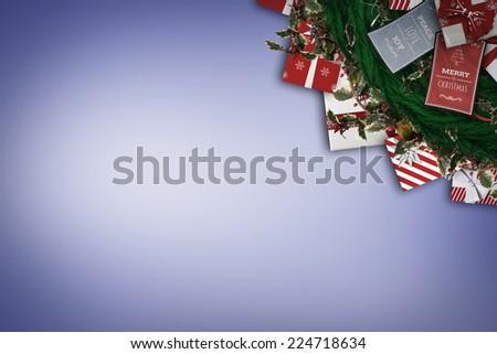Festive christmas wreath with decorations against purple vignette - stock photo
