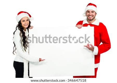 Festive couple showing a poster on white background
