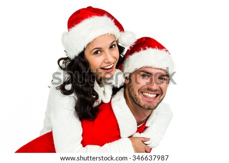 Festive couple smiling at camera on white background