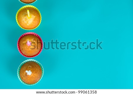 Festive cupcakes with a candles on gradient background,top view - stock photo