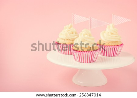 Festive cupcakes with frosting. toned - stock photo