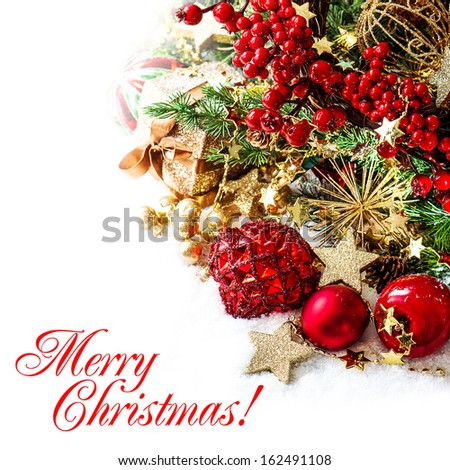 festive decoration with baubles, golden garlands, christmas tree and red berries. Card concept with sample text Merry Christmas!
