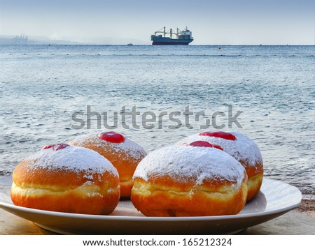Festive donuts on background of the Red Sea, Israel  - stock photo