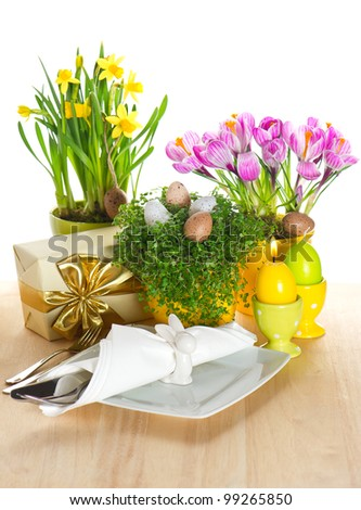 festive easter table setting with spring flowers and eggs decoration on white background. selective focus - stock photo