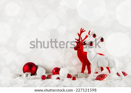 Festive elegant christmas background in classical colors red and white with deers. - stock photo