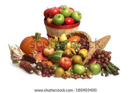 Festive fall still life with cornucopia, pumpkin, and basket of apples - stock photo