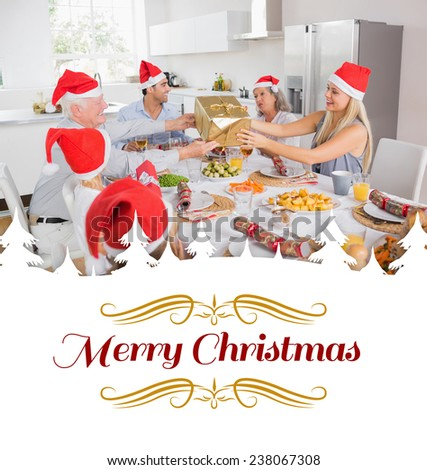 Festive family exchanging gifts against border - stock photo
