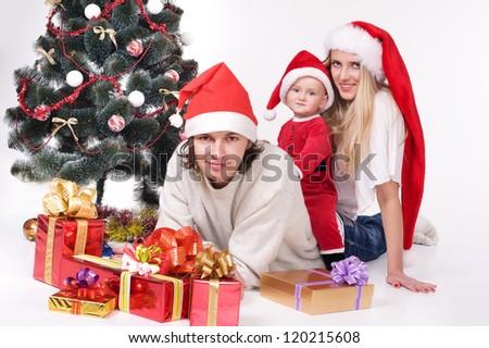 festive family waiting for christmas. studio shot over white background - stock photo