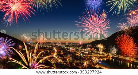 Festive fireworks display over the city, a panoramic aerial view of the scenic cityscape of Heidelberg, Germany, at dusk - stock photo