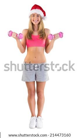 Festive fit blonde holding dumbbells on white background - stock photo