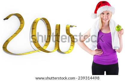 Festive fit blonde smiling at camera holding apple against 2015 tape - stock photo