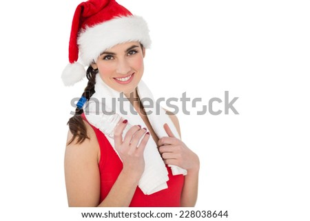 Festive fit brunette smiling at camera on white background - stock photo
