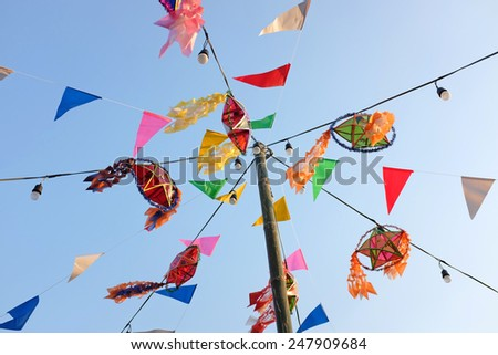 Festive flags against blue sky - stock photo