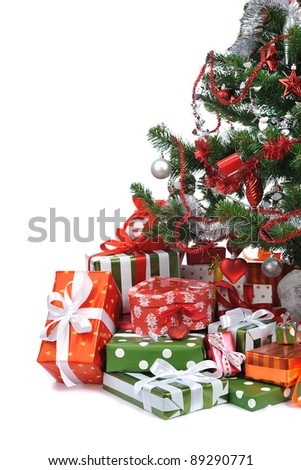 festive gifts  under decorated Christmas tree - stock photo