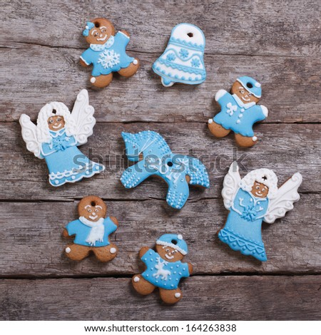 Festive gingerbread cookies on wooden table background - stock photo