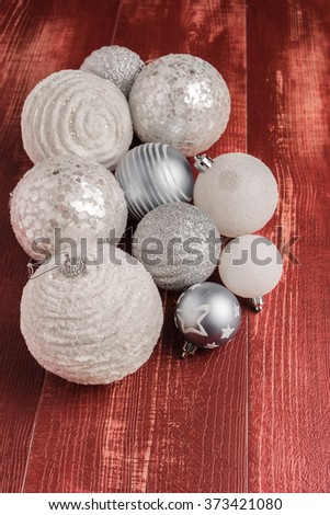 Festive glitter christmas balls decorations on rustic wooden table. Seasonal winter holidays. Top view with copy space - stock photo