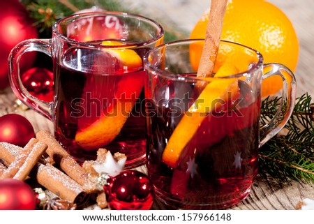 festive glitter christmas decoration bauble seasonal wintehot tasty spicy mulled red wine with orange and cinnamon christmas time winter  - stock photo