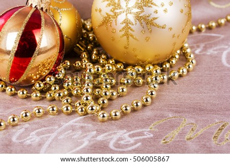 Festive gold Christmas decorations on a fabric background