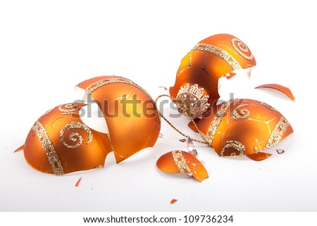 festive golden bauble christmas decoration broken in pieces isolated on white - stock photo