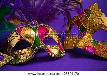 Festive Grouping of mardi gras, venetian or carnivale mask on a purple background - stock photo