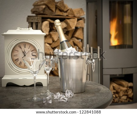 festive home interior with champagne, vintage clock and fireplace. selective focus - stock photo