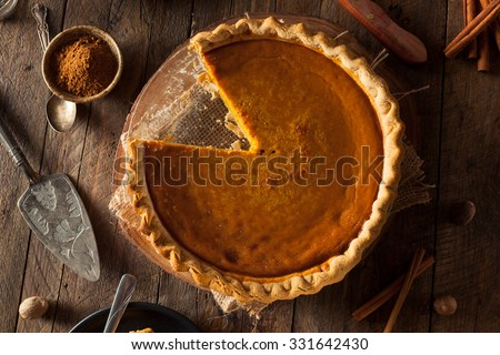 Festive Homemade Pumpkin Pie with Whipped Cream - stock photo