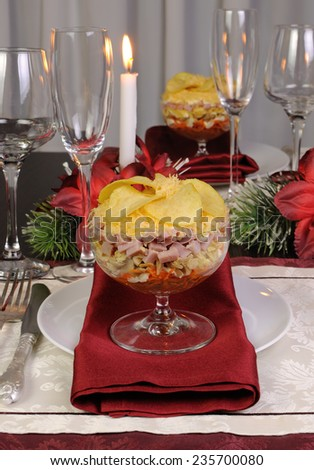 Festive layered salad in a glass goblet