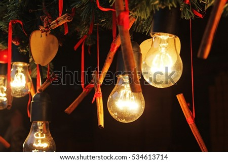 Festive lights with cinnamon on a dark background