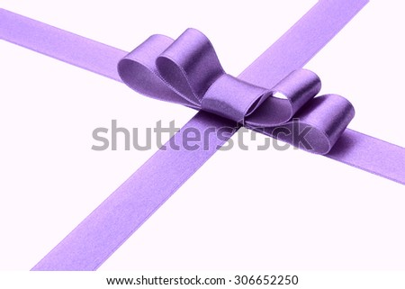 Festive lilac  gift ribbon and bow  - stock photo