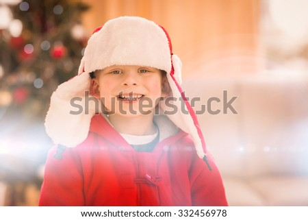 Festive little boy smiling at camera at home in the living room