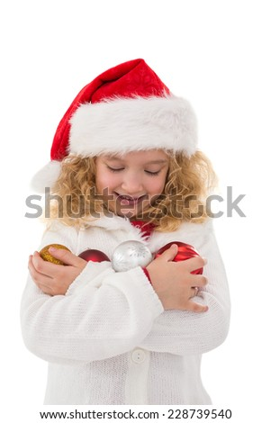 Festive little girl holding baubles on white background