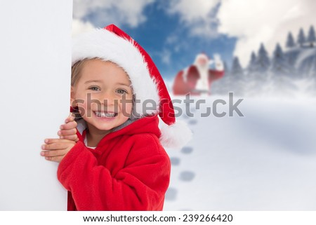 Festive little girl showing poster against blue sky with white clouds - stock photo
