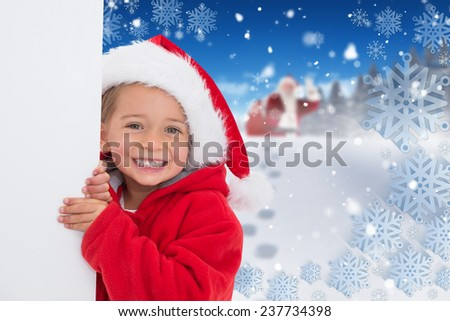 Festive little girl showing poster against bright blue sky over clouds - stock photo