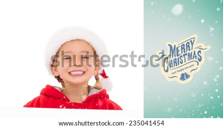 Festive little girl showing poster against green vignette - stock photo