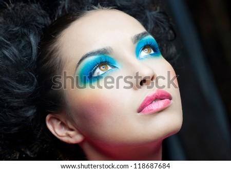 Festive makeup on beautiful face of girl - stock photo