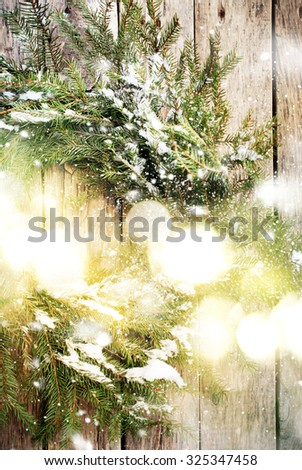 Festive Natural Wreath with Christmas Light on Wooden Background, warm toned - stock photo