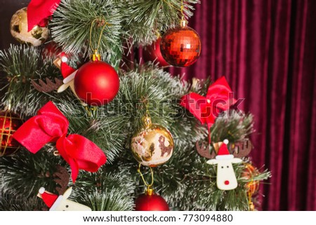 Festive New Year background. Christmas card. Toy hanging on a green pine