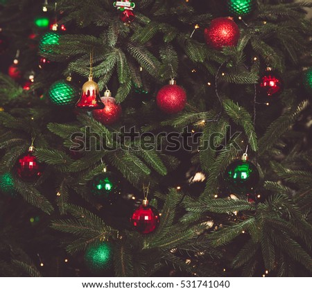 Festive ornate background with Christmas tree brunches and traditional decoration elements