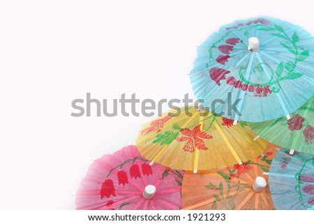 festive paper umbrellas in the corner - stock photo