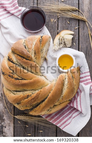 Festive poppy seed wreath bread with honey - stock photo