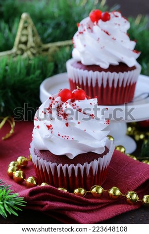 festive red velvet cupcakes Christmas table setting - stock photo