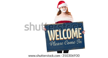 Festive redhead in foam beard holding poster against vintage open sign - stock photo