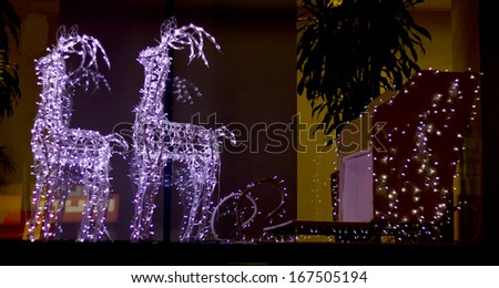 Festive reindeer decorated with lights in the city. Kiev, Ukraine, 12 december 2013   - stock photo