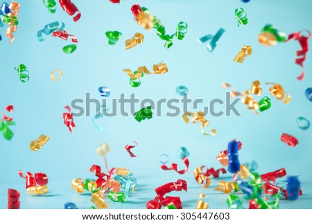 Festive ribbon flying on blue background