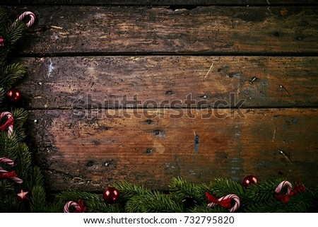 Festive Rustic Christmas Border On Old Vintage Wood With Copy Space Formed Of Fresh Pine And