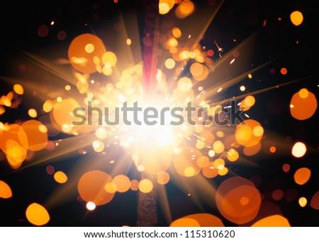 festive sparkler with shiny glare - stock photo