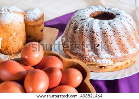 Festive sweet cake and Easter eggs - stock photo
