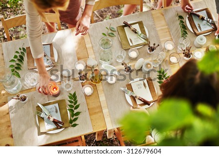 Festive table being served by girls - stock photo