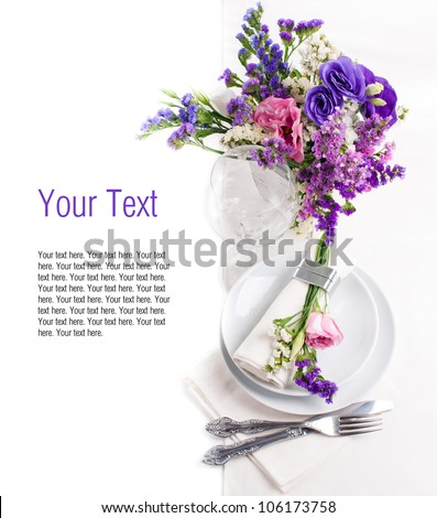 Festive table setting and decoration with colorful fresh flowers - stock photo
